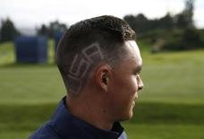 """The word """"USA"""" is seen on U.S. Ryder Cup player Rickie Fowler's hair, during practice ahead of the 2014 Ryder Cup at Gleneagles in Scotland September 22, 2014.   REUTERS/Russell Cheyne"""