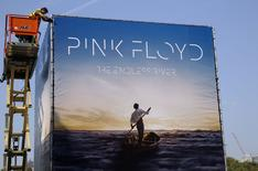 "Advertising for the new Pink Floyd album ""The Endless River"" is installed on a four sided billboard on the South Bank in London September 22, 2014. The album cover was designed by 18 year old Egyptian digital artist Ahmed Emad Eldin and the album is released on November 10, 2014. REUTERS/Luke MacGregor (BRITAIN - Tags: ENTERTAINMENT)"