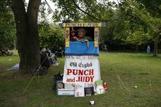 "Punch and Judy ""professor"" Adrienne Press poses for a photograph at Forty Hall in Enfield, north London June 1, 2014. REUTERS/Stefan Wermuth"