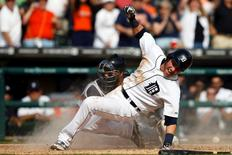 Sep 28, 2014; Detroit, MI, USA; Detroit Tigers shortstop Andrew Romine (27) slides in safe at home ahead of the throw to Minnesota Twins catcher Josmil Pinto (43) in the eighth inning at Comerica Park. Mandatory Credit: Rick Osentoski-USA TODAY Sports