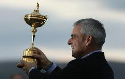 Captain Paul McGinley poses with the Ryder Cup after the closing ceremony of the 40th Ryder Cup at Gleneagles in Scotland September 28, 2014. REUTERS/Phil Noble