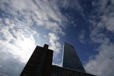 The tower of the new European Central bank (ECB) (R) is pictured next to the former market hall 'Grossmarkthalle' at the site of the new ECB headquarters in Frankfurt, September 11, 2014.  REUTERS/Ralph Orlowski