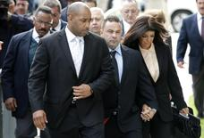 """Teresa and Giuseppe """"Joe"""" Giudice, stars of the reality television series """"Real Housewives of New Jersey"""" hold hands as they arrive at U.S. federal court in Newark, New Jersey, October 2, 2014. REUTERS/Mike Segar"""