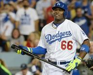 October 3, 2014; Los Angeles, CA, USA; Los Angeles Dodgers right fielder Yasiel Puig (66) reacts after striking out in the ninth inning against the St. Louis Cardinals in game one of the 2014 NLDS playoff baseball game at Dodger Stadium. Mandatory Credit: Jayne Kamin-Oncea-USA TODAY Sports