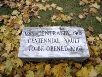 A time capsule buried in Centralia, Pennsylvania, in 1966 is noted by this marker in the yard of the Centralia American Legion post in Centralia, Pennsylvania November 17, 2007. REUTERS/David Dekok