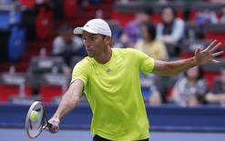 Ivo Karlovic of Croatia returns a shot during his men's singles tennis match against Marin Cilic of Croatia at the Shanghai Masters tennis tournament October 6, 2014. REUTERS/Aly Song