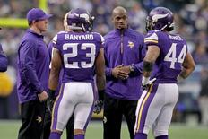Dec 15, 2013; Minneapolis, MN, USA; Minnesota Vikings injured running back Adrian Peterson (28) and running back Toby Gerhart (32) talk to running back Matt Asiata (44) and running back Joe Banyard (23) during the second quarter against the Philadelphia Eagles at Mall of America Field at H.H.H. Metrodome. Mandatory Credit: Brace Hemmelgarn-USA TODAY Sports