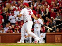 Oct 7, 2014; St. Louis, MO, USA; St. Louis Cardinals first baseman Matt Adams (32) hits a three-run home run against the Los Angeles Dodgers in the 7th inning during game four of the 2014 NLDS baseball playoff game at Busch Stadium. Mandatory Credit: Jeff Curry-USA TODAY Sports