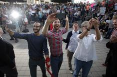 """(L to R) Plaintiffs Moudi Sbeity and his partner Derek Kitchen, Kody Partridge and her wife Laurie Wood take a a """"selfie"""" as they celebrate at a same-sex marriage rally in Salt Lake City, Utah, October 6, 2014. REUTERS/Jim"""