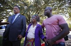 Nowai Korkoyah, the mother of Thomas Eric Duncan, the first patient diagnosed with Ebola on U.S. soil, walks with Reverend Jesse Jackson (L) in Dallas, Texas October 7, 2014. At right is Duncan's nephew Josephus Weeks. REUTERS/Jim Young