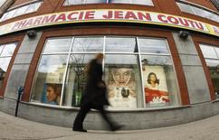 A pedestrian walks past a Jean Coutu pharmacy in downtown Montreal, April 28, 2010. REUTERS/Shaun Best