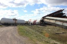 The wreckage of a Canadian National Railway Co train that derailed near Clair, Saskatchewan is pictured west of Wadena, October 7, 2014. REUTERS/Alison J. Squires/Wadena News