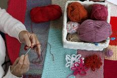 A woman knits during the Knitting and Stitching show at Alexandra Palace in London, October 8, 2014. REUTERS/Stefan Wermuth