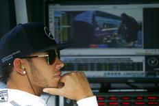 Mercedes Formula One driver Lewis Hamilton of Britain attends the first free practice session at the Russian F1 Grand Prix in the Sochi Autodrom circuit October 10, 2014.  REUTERS/Laszlo Balogh
