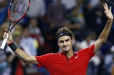 Roger Federer of Switzerland celebrates winning his men's singles semi-final match against Novak Djokovic of Serbia at the Shanghai Masters tennis tournament in Shanghai October 11, 2014. REUTERS/Aly Song