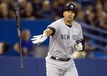 New York Yankees Alex Rodriguez tosses his bat after flying out against the Toronto Blue Jays in the ninth inning of their American League MLB baseball game in Toronto September 18, 2013.   REUTERS/Fred Thornhill