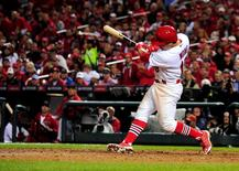 Oct 12, 2014; St. Louis, MO, USA; St. Louis Cardinals second baseman Kolten Wong hits the game-winning solo home run against the San Francisco Giants during the 9th inning in game two of the 2014 NLCS playoff baseball game at Busch Stadium. Jeff Curry-USA TODAY Sports