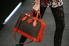 A model presents a creation by French designer Nicolas Ghesquiere as part of his Spring/Summer 2015 women's ready-to-wear collection for fashion house Louis Vuitton during Paris Fashion Week October 1, 2014.    REUTERS/Gonzalo Fuentes