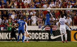 Oct 14, 2014; Boca Raton, FL, USA; Honduras defender Maynor Figueroa (3 ) heads the ball for a goal against the United States in the second half at FAU Stadium. The match ended in a 1-1 tie. Robert Mayer-USA TODAY Sports