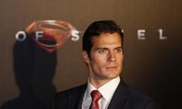 """Cast member Henry Cavill poses for pictures after his arrival to the Australian premiere of """"Man of Steel"""" in central Sydney June 24, 2013. REUTERS/Daniel Munoz"""