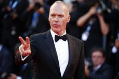 """U.S. actor Michael Keaton poses during the red carpet for the movie """"Birdman or (The unexpected virtue of ignorance)"""" at the 71st Venice Film Festival August 27, 2014. REUTERS/Tony Gentile"""