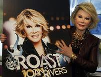 """U.S. artist Joan Rivers poses for photographers as she presents """"Comedy Roast with Joan Rivers"""" at the annual MIPCOM television programme market in Cannes, southeastern France, October 6, 2009. REUTERS/Eric Gaillard"""