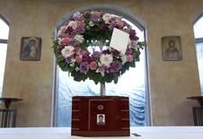 The urn containing the ashes of Jun Lin sits in a funeral home prior to the funeral services in Montreal, in a July 26, 2012 file photo.  REUTERS/Christinne Muschi/files