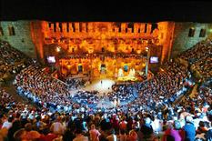 People watch the popular German entertainment show 'Wetten Dass...?' ('Bet it...?') hosted by Thomas Gottschalk at the ancient Roman amphitheatre of Aspendos near the Turkish Mediterranean resort city of Antalya in this May 15, 2005 file photograph.  REUTERS/Umit Bektas/Files