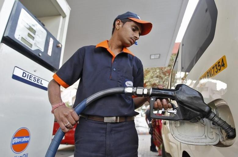 A worker fills diesel in a vehicle at a fuel station in the western Indian city of Ahmedabad January 17, 2013. REUTERS/Amit Dave/Files