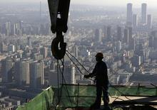 A worker operates at a construction site on the 68th storey of a building in Shenyang, Liaoning province, October 16, 2014. REUTERS/Stringer