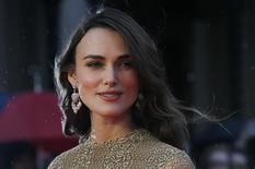 """Actress Keira Knightley poses as she arrives for the European premiere of the film """"The Imitation Game"""" at the BFI opening night gala at Leicester Square in London October 8, 2014. REUTERS/Suzanne Plunkett"""