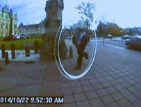A man identified by Royal Canadian Mounted Police as Michael Zehaf-Bibeau is seen October 22, 2014 as he exits a car and runs toward the Parliament buildings in a still image taken from surveillance video released by the RCMP October 23, 2014.   REUTERS/CBC via Reuters TV