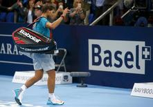 Spain's Rafael Nadal leaves after losing his match against Borna Coric of Croatia at the Swiss Indoors ATP tennis tournament in Basel October 24, 2014. REUTERS/Arnd Wiegmann