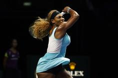 Serena Williams of the U.S. hits a return to Simona Halep of Romania during their women's singles final tennis match of the WTA Finals at the Singapore Indoor Stadium October 26, 2014. REUTERS/Edgar Su