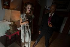 Actors depicting the legends of ghosts living inside New York's landmark Dakota apartment building are seen inside Nightmare: New York, a haunted house for adults, in New York October 22, 2014.     REUTERS/Mike Segar