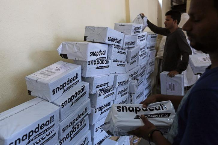 Employees of Snapdeal, an Indian online retailer, sort out delivery packages inside their company fulfilment centre in Mumbai October 22, 2014. REUTERS/Shailesh Andrade