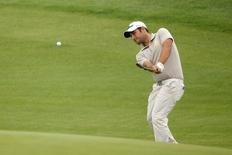 Alexander Levy of France plays a shot on the third hole during the first round of the BMW Masters 2014 golf tournament at Lake Malaren Golf Club in Shanghai October 30, 2014. REUTERS/Aly Song
