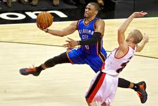 Oct 29, 2014; Portland, OR, USA; Oklahoma City Thunder guard Russell Westbrook (0) shoots over Portland Trail Blazers guard Steve Blake (25) during the third quarter at the Moda Center. Mandatory Credit: Craig Mitchelldyer-USA TODAY Sports