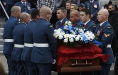 Pallbearers carry the casket of Warrant Officer Patrice Vincent following his funeral in Longueuil, Quebec November 1, 2014. REUTERS/Chris Wattie