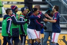 Nov 1, 2014; Columbus, OH, USA; New England Revolution forward Charlie Davies (9) celebrates his second goal with his teammates in the second half of play against the Columbus Crew at Crew Stadium. New England Revolution beat the Columbus Crew by the score of 4-2. Mandatory Credit: Trevor Ruszkowski-USA TODAY Sports