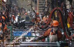 L'économie chinoise continue de s'essouffler à l'entame du dernier trimestre avec les difficultés persistantes du marché de l'immobilier et des perspectives peu encourageantes pour les exportations. /Photo d'archives/REUTERS