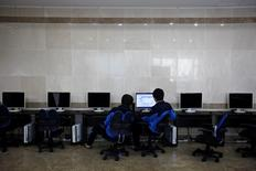 Students retaking the college entrance exams use a public computer during recess at a school in Kwangju, some 40 km (25 miles) southeast of Seoul in this October 30, 2012 file photo. REUTERS/Kim Hong-Ji/Files