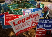 A DC Cannabis Campaign sign is seen with other campaign signs  in Washington November 4, 2014.         REUTERS/Gary Cameron