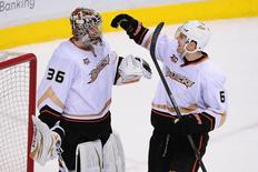 Apr 7, 2014; Vancouver, British Columbia, CAN; Anaheim Ducks goaltender John Gibson (36) is congratulated by defenseman Ben Lovejoy (6) after the game against the Vancouver Canucks at Rogers Arena. The Anaheim Ducks won 3-0. Mandatory Credit: Anne-Marie Sorvin-USA TODAY Sports
