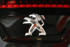 A Peugeot logo is seen on a car which is displayed at PSA Peugeot Citroen headquarters in Paris April 14, 2014. REUTERS/Benoit Tessier