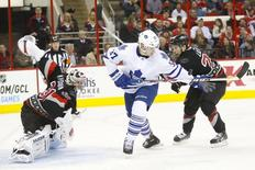 Jan 9, 2014; Raleigh, NC, USA; Carolina Hurricanes goalie Anton Khudobin (31) watches the puck go past Toronto Maple Leafs  forward Carter Ashton (37) during the 2nd period at PNC Arena. Mandatory Credit: James Guillory-USA TODAY Sports
