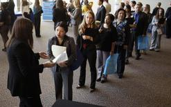 Jobseekers wait to talk to a recruiter (L) at the Colorado Hospital Association's health care career event in Denver October 13, 2014. Hundreds of applicants met with several health care providers with current job openings during the event. REUTERS/Rick Wilking