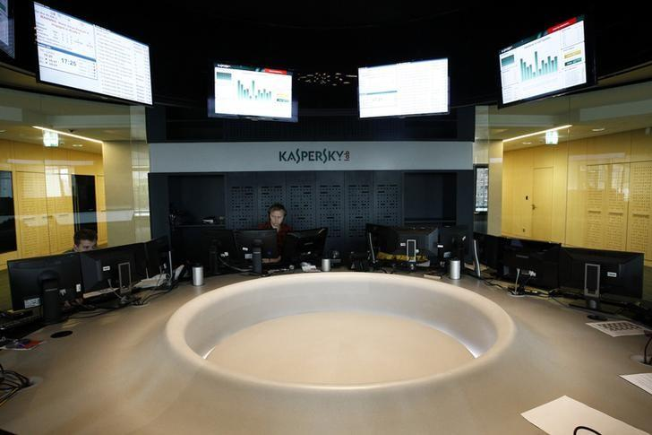Employees work at the headquarters of Kaspersky Labs, a company which specialises in the production of antivirus and internet security software, in Moscow July 29, 2013. Picture taken July 29, 2013. REUTERS/Sergei Karpukhin/Files