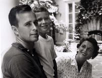George W. Bush is shown with his father, George Bush and mother, Barbara Bush in Rye, New York, in this file photo taken during the summer of 1955.