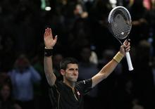 Novak Djokovic of Serbia celebrates winning his tennis match against Marin Cilic of Croatia at the ATP World Tour finals at the O2 Arena in London November 10, 2014. REUTERS/Stefan Wermuth